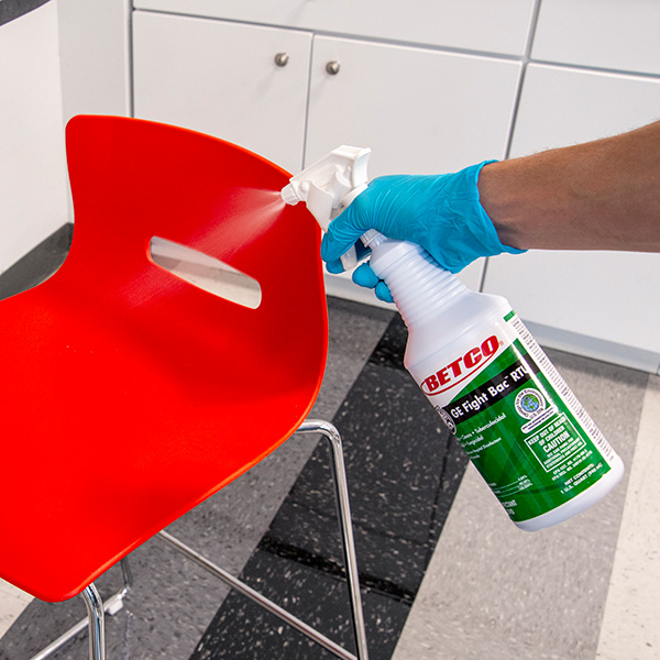 Disinfecting with a spray bottle of GE Fight Bac RTU