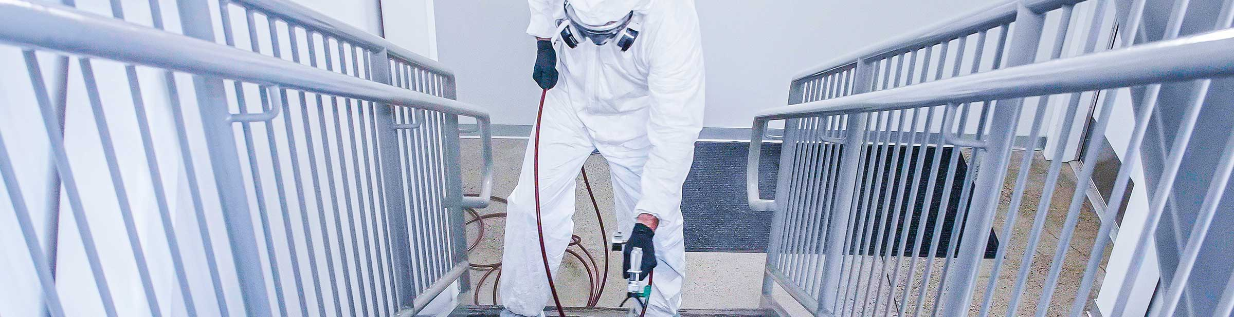Person wearing PPE.