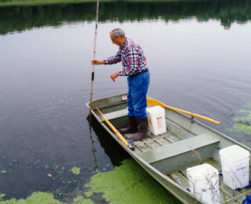 Measuring sludge depth in a lagoon